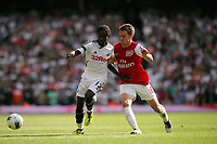 Pictured L-R: Nathan Dyer of Swansea against Aaron Ramsey of Arsenal. Saturday 10 September 2011<br />