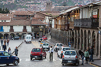 Peru, Cusco.  Colonial Arches and Balconies Line one Side of the Plaza de Armas.