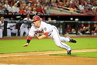 Apr. 6, 2009; Phoenix, AZ, USA; Arizona Diamondbacks shortstop Stephen Drew dives safely into home to score in the third inning against the Colorado Rockies during opening day 2009 at Chase Field. Mandatory Credit: Mark J. Rebilas-