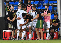 LAKE BUENA VISTA, FL - AUGUST 01: Andy Polo #7 of the Portland Timbers celebrates his goal with his teammates on the bench during a game between Portland Timbers and New York City FC at ESPN Wide World of Sports on August 01, 2020 in Lake Buena Vista, Florida.