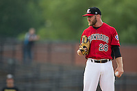 Hickory Crawdads relief pitcher Shane McCain (28) looks to his catcher for the sign against the West Virginia Power at L.P. Frans Stadium on August 15, 2015 in Hickory, North Carolina.  The Power defeated the Crawdads 9-0.  (Brian Westerholt/Four Seam Images)