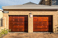 South Africa, Cape Town, Athlone Suburb.  Two Security Company Signs Announce Protection Enjoyed by this Private Home.