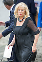 Shona Jardine, wife of Sandy leaves Mortonhall Crematorium after the service.