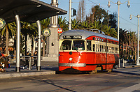 San Francisco, California, USA. Vintage Electric Street Car Approaching Ferry Building Stop.