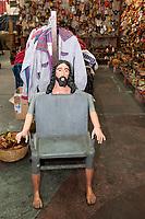 Antigua, Guatemala.  Jesus Chair.  Nim Po't Handicrafts Outlet.