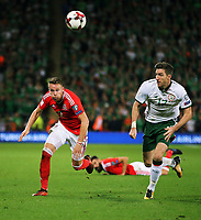 (L-R) Chris Gunter of Wales runs for the ball next to James McCarthy of Ireland during the FIFA World Cup Qualifier Group D match between Wales and Republic of Ireland at The Cardiff City Stadium, Wales, UK. Monday 09 October 2017