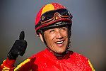 Jockey, DAVID FLORES celebrates  winning the 2013 running of the Vicente Stakes at Santa Anita Park in Arcadia aboard Shakin it Up, California on February 17, 2013.