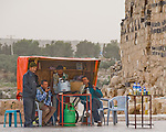"""""""Snack Shop"""" -- Four local men relax at the only refreshment stand outside the ruins of Gadara, at Umm Qais, northwestern Jordan.  © Rick Collier"""
