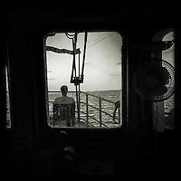 Sea Watch-2.<br /> Die Sea Watch-2 bei ihrer 13. SAR-Mission vor der libyschen Kueste.<br /> Im Bild: Ein Crewmitglied sitz auf dem Brueckendeck.<br /> 20.10.2016, Mediterranean Sea<br /> Copyright: Christian-Ditsch.de<br /> [Inhaltsveraendernde Manipulation des Fotos nur nach ausdruecklicher Genehmigung des Fotografen. Vereinbarungen ueber Abtretung von Persoenlichkeitsrechten/Model Release der abgebildeten Person/Personen liegen nicht vor. NO MODEL RELEASE! Nur fuer Redaktionelle Zwecke. Don't publish without copyright Christian-Ditsch.de, Veroeffentlichung nur mit Fotografennennung, sowie gegen Honorar, MwSt. und Beleg. Konto: I N G - D i B a, IBAN DE58500105175400192269, BIC INGDDEFFXXX, Kontakt: post@christian-ditsch.de<br /> Bei der Bearbeitung der Dateiinformationen darf die Urheberkennzeichnung in den EXIF- und  IPTC-Daten nicht entfernt werden, diese sind in digitalen Medien nach §95c UrhG rechtlich geschuetzt. Der Urhebervermerk wird gemaess §13 UrhG verlangt.]