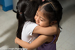 Education preschool 4 year olds two girls giving each other a spontaeous hug