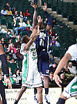 Jackson State Tigers guard Tyrone Hanson (10) shots a jump shot over North Texas Mean Green guard Shannon Shorter (21)  in the game between the Jackson State Tigers and the University of North Texas Mean Green at the North Texas Coliseum,the Super Pit, in Denton, Texas. UNT defeated Jackson 68 to 49