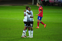 Kasey Palmer of Swansea City hugs team mate André Ayew at full time during the Sky Bet Championship match between Swansea City and Blackburn Rovers at the Liberty Stadium in Swansea, Wales, UK. Saturday 31 October 2020