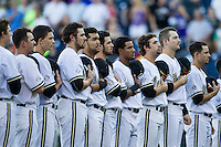 Vanderbilt Commodores lineup for the National Anthem before Game 12 of the NCAA College World Series against the TCU Horned Frogs on June 19, 2015 at TD Ameritrade Park in Omaha, Nebraska. The Commodores defeated TCU 7-1. (Andrew Woolley/Four Seam Images)