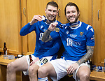 Livingston v St Johnstone …28.02.21   Hampden   BetFred Cup Final<br /> David Wotherspoon and Stevie May show off their medals in the dressing room after winning the BETFRED Cup<br /> Picture by Graeme Hart.<br /> Copyright Perthshire Picture Agency<br /> Tel: 01738 623350  Mobile: 07990 594431