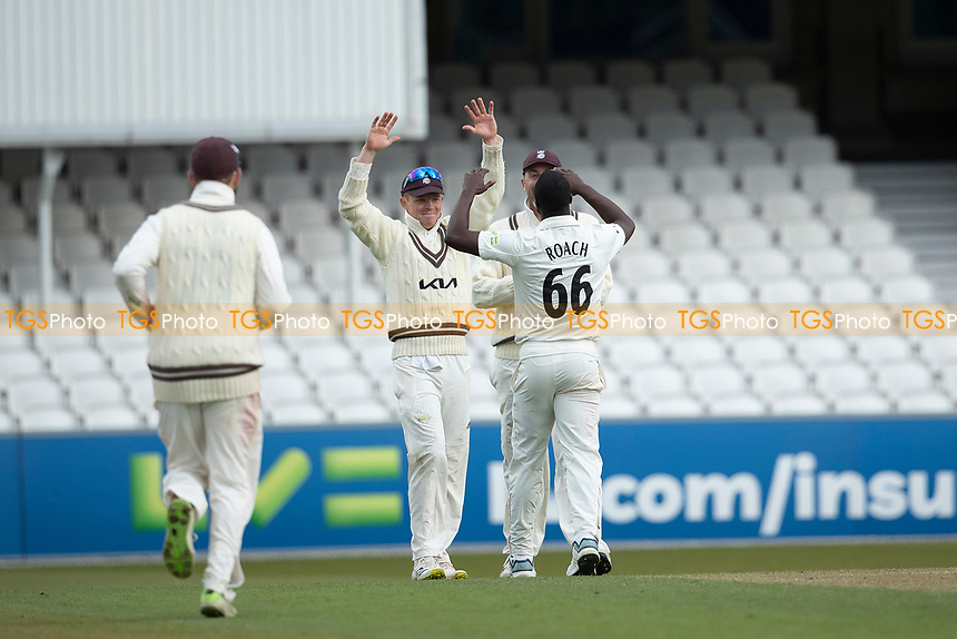 High Fives - Ollie Pope celebrates with Kemar Roach as  Roach finishes with 8-40 during Surrey CCC vs Hampshire CCC, LV Insurance County Championship Group 2 Cricket at the Kia Oval on 1st May 2021