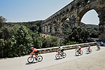 The breakaway featuring Lukasz Wisniowski (POL) CCC Team, Lars Ytting Bak (DEN) Dimension Data, Stephane Rossetto (FRA) Cofidis, Paul Ourselin (FRA) Total Direct Energie and Alexis Gougeard (FRA) AG2R La Mondiale pass beneath Pont du Gard during Stage 16 of the 2019 Tour de France running 177km from Nimes to Nimes, France. 23rd July 2019.<br /> Picture: ASO/Pauline Ballet   Cyclefile<br /> All photos usage must carry mandatory copyright credit (© Cyclefile   ASO/Pauline Ballet)