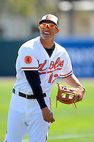 Baltimore Orioles third baseman Manny Machado #13 warms up before a Spring Training game against the Toronto Blue Jays at Ed Smith Stadium on March 7, 2013 in Sarasota, Florida.  Balitmore defeated Toronto 11-10.  (Mike Janes/Four Seam Images)