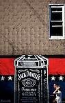 Locals walk past a Jack Daniels wall mural on N 5th Street, Williamsburg near Bedford street and the East River in Brooklyn, New York.
