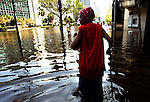 72-year-old Katie Lavigne wades through flood water near the Super Dome in downtown New Orelans on Wednesday, August 31, 2005.  Hurricane Katrina caused many parts of the city to flood.  (photo by Khampha Bouaphanh)