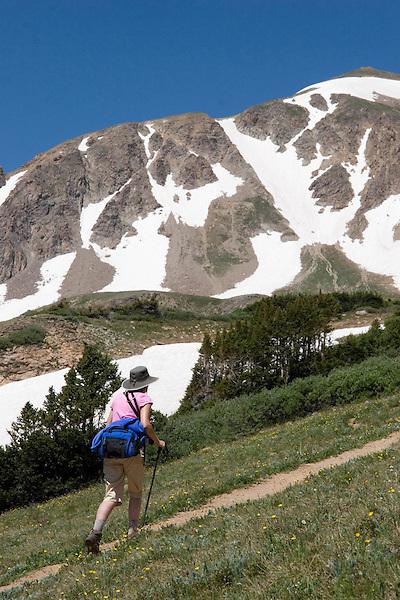 Woman hiking Herman Gulch Trail in James Peak Wilderness Area, west of Bakerville, Colorado.