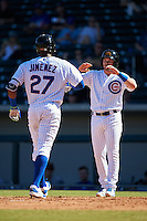 Mesa Solar Sox Ian Happ (right) congratulates Eloy Jimenez (27), both of the Chicago Cubs organization, after hitting a home run during a game against the Surprise Saguaros on October 14, 2016 at Sloan Park in Mesa, Arizona.  Mesa defeated Surprise 10-4.  (Mike Janes/Four Seam Images)