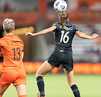 HOUSTON, TX - SEPTEMBER 10: Sarah Woldmoe #16 of the Chicago Red Stars heads the ball away from Sophie Schmidt #13 of the Houston Dash during a game between Chicago Red Stars and Houston Dash at BBVA Stadium on September 10, 2021 in Houston, Texas.
