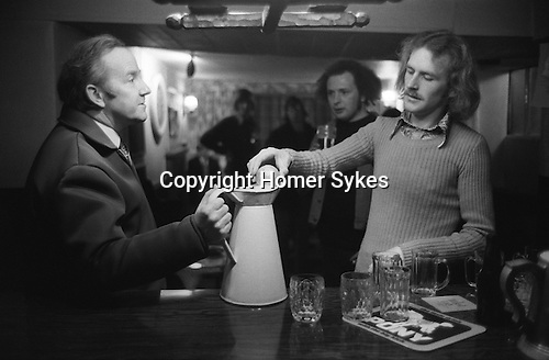 Hurling the Silver Ball. St Columb, Cornwall, England 1974. <br /> Played annually on Shrove Tuesday. At St Columb hurling is played by two teams comprising of of Townsmen and Countrymen.<br /> After the game, that evening, the silver ball is placed in a jug of ale by David Juszczak. Silver beer is provided in all the pubs in the village and is on the house.