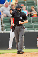 Home plate umpire Junior Valentine during the South Atlantic League game between the Rome Braves and the Kannapolis Intimidators at CMC-Northeast Stadium on August 5, 2012 in Kannapolis, North Carolina.  The Intimidators defeated the Braves 9-1.  (Brian Westerholt/Four Seam Images)