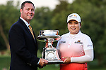 Commissioner Michael Whan (L) and South Korean Inbee Park (R) hold the LPGA Championship Trophy at Locust Hill Country Club in Pittsford, NY on June 9, 2013