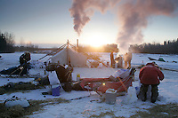 Wednesday March 7, 2007   As the sun rises, Mike Williams begins to cook dog food  at the Nikolai checkpoint on Wednesday in 35 below temperatures