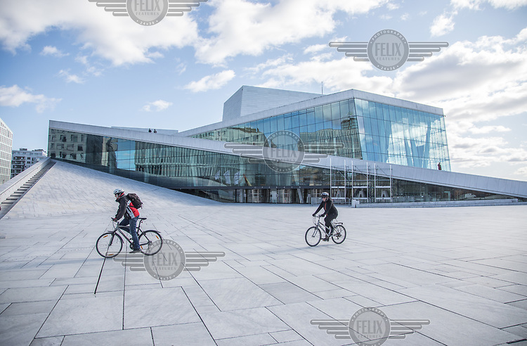 Very few poeple outside the Oslo Opera  House, normally very busy with tourists. <br /> <br /> Norwegian authorites introduced measures to combat the Coronavirus (COVID-19).<br /> <br /> Restriction on public gatherings, closure of schhols, new rules for those serving food and drinks, and fear of further spread of the virus have brought the country to a stand still. <br /> <br /> ©Fredrik Naumann/Felix Features