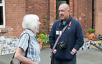 Hylda Sims, ex-pupil and ex-parent chatting to Steve Fawdry, parent and editor of the Summerhill Newsletter, at the reunion for Summerhill School's 90th birthday celebrations.