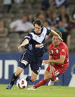 MELBOURNE, AUSTRALIA - OCTOBER 30: Fabian Barbiero of United and Robbie Kruse of the Victory compete for the ball during the round 12 A-League match between the Melbourne Victory and Adelaide United at Etihad Stadium on October 30, 2010 in Melbourne, Australia.  (Photo by Sydney Low / Asterisk Images)