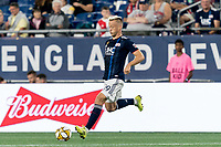 FOXBOROUGH, MA - SEPTEMBER 21: Antonio Mlinar Delamea #19 of New England Revolution passes the ball during a game between Real Salt Lake and New England Revolution at Gillette Stadium on September 21, 2019 in Foxborough, Massachusetts.