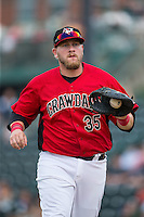 Hickory Crawdads first baseman Jonathan Meyer (35) jogs off the field between innings of the game against the West Virginia Power at L.P. Frans Stadium on August 15, 2015 in Hickory, North Carolina.  The Power defeated the Crawdads 9-0.  (Brian Westerholt/Four Seam Images)