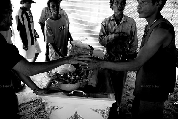 Villagers drink locally made whisky throughout the day. By late morning, most are visibly intoxicated.<br /> <br /> On April 27, Mrs Mool Klatalay was savagely beaten by her drunken husband. The beating took place in the hovel where Mool lived in a small sea gypsy village in southern Thailand's Phang Nga province. Villagers heard her screams, but no one intervened. No one took her to hospital. She died at home 48 hours later, after losing four pints of blood through internal bleeding. She leaves two sons, aged 19 and 12, and a daughter, aged 3.