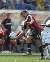Pressured, AC Milan defender Francesco Acerbi (13) passes back to goalkeeper. In an international friendly, AC Milan defeated C.D. Olimpia, 3-1, at Gillette Stadium on August 4, 2012.