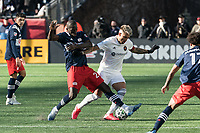 FOXBOROUGH, MA - MARCH 7: Wilfried Zahibo #23 of New England Revolution tackles Francisco Calvo #5 of Chicago Fire during a game between Chicago Fire and New England Revolution at Gillette Stadium on March 7, 2020 in Foxborough, Massachusetts.