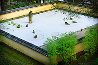 "The sand and stone garden (Karesansui) surrounded by wall capped with Gifu tile in the Portland Japanese Garden.   The sand and seven carefully placed rocks reflects Japanese aesthetic principle of ""the beauty of blank space""."