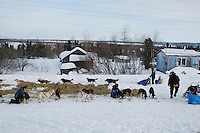 Ray Redington Jr. leaves the Shageluk checkpoint as veterinarians check out Ed Stielstra 's dogs on Saturday morning    Iditarod 2009