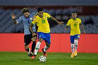 17th November 2020; Centenario Stadium, Montevideo, Uruguay; Fifa World Cup 2022 Qualifying football; Uruguay versus Brazil;  Nahitan Nández of Uruguay held off by Roberto Firmino of Brazil