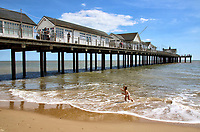 With the beaches in England now fully opened with only social distancing measures in force, people are taking the chance to visit some coastal resorts.  Plenty of people of all ages were out and about on the sandy beach and on the pier. Southwold, Suffolk. Sunday July 12th 2020<br /> <br /> Photo by Keith Mayhew