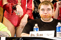 """Dr. Slob"" at the 14th annual Wing Bowl, held in Philadelphia on February 3, 2006 at the Wachovia Center.<br /> <br /> The Wing Bowl is a competitive eating event in which eaters try and down the most hot wings in 30 total minutes in front of a crowd of 10,000 plus people.  The real show however is all around the eaters, from the various scantily clad women (known as ""Wingettes"") that make up eaters' entourages, to the behavior of the fans themselves."