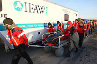 """A mother and calf common dolphin are transported to the beach by a team from the International Fund for Animal Welfare (IFAW) and the New England Aquarium before being released back into Cape Cod Bay at Scusset Beach in Sagamore Beach.  The dolphins are two of at an estimated 30 dolphins that stranded along Cape Cod Bay's shores from Dennis to Wellfleet.  11 dolphins were successfully released back into the bay.  """"This might be the largest dolphin stranding geographically speaking that we've had,"""" says Brian Sharp, IFAW's stranding coordinator."""
