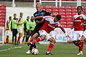 Jordan Burrow of Stevenage tangles with Yaser Kasim of Swindon<br />  Swindon Town v Stevenage - Sky Bet League One- The County Ground, Swindon - 10th August 2013<br /> © Kevin Coleman 2013