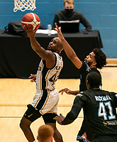 Rahmon Fletcher of Newcastle Eagles drives to the basket during the BBL Championship match between Surrey Scorchers and Newcastle Eagles at Surrey Sports Park, Guildford, England on 20 March 2021. Photo by Liam McAvoy.
