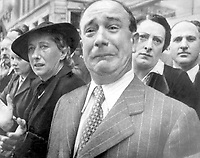 A Frenchman weeps as German soldiers march into the French capital, Paris, on June 14, 1940, after the Allied armies have been driven back across France.  (OWI)<br /> NARA FILE #:  208-PP-10A-3<br /> WAR & CONFLICT BOOK #:  997