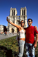 France Holiday picture of college girl and man tourists taken photo at Notre Dame Cathedral in Paris France