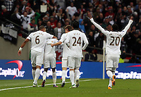 Pictured: Nathan Dyer of Swansea  (2nd L)  celebrating his goal with team mate Ashley Williams (L) and other players. Sunday 24 February 2013<br /> Re: Capital One Cup football final, Swansea v Bradford at the Wembley Stadium in London.
