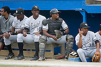 Jedon Matthews (10) and Orlando Santos (23) share a laugh at Burlington Athletic Park in Burlington, NC, Sunday, August 26, 2007.